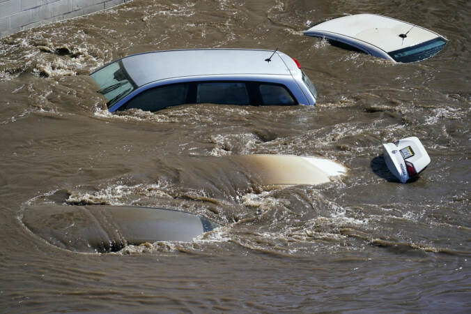 Vehicles are under floodwater from Schuylkill River