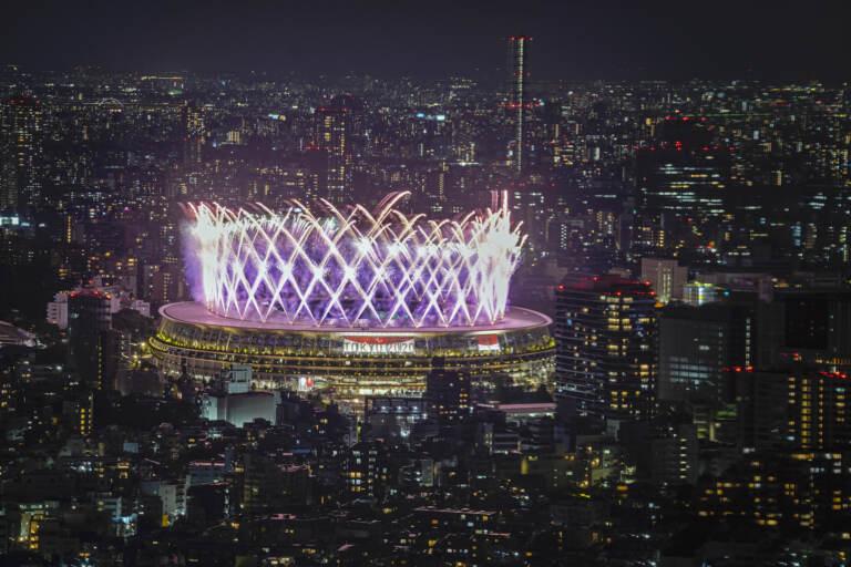 Fireworks illuminate over National Stadium viewed from Shibuya Sky observation deck