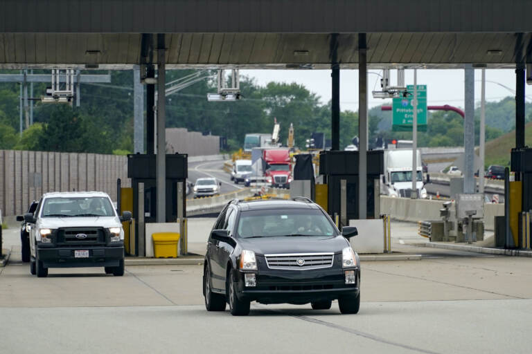 Traffic going eastbound on the Pennsylvania Turnpike proceeds through the electronic toll booths