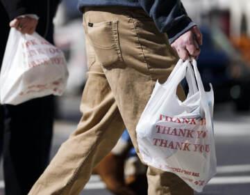 Pedestrians carry plastic bags in Philadelphia