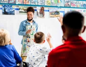 Art teacher in front on students