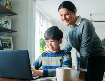 Mother and son looking at a laptop together