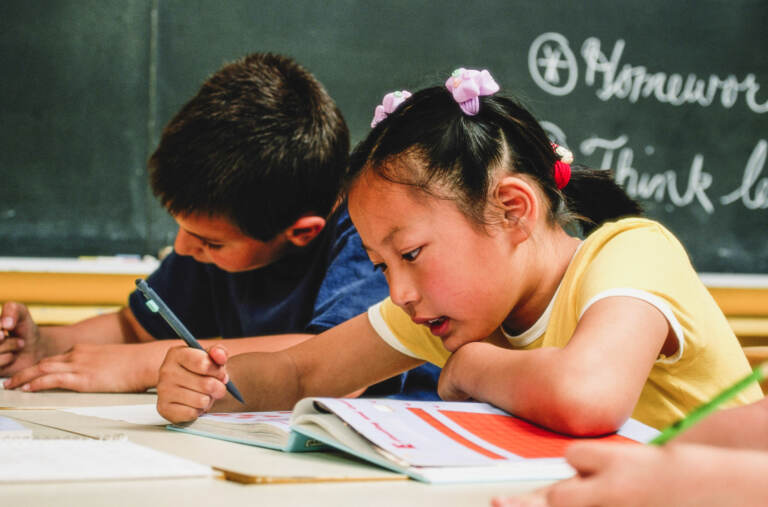 A young girl and young boy in school