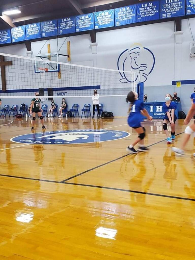 At this recent Immaculate Heart of Mary volleyball game, players, officials and spectators wore masks as required by Gov. Carney's order