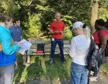Artist JJ Tizou leads a walking tour around Philadelphia. (Aaron Moselle / WHYY)