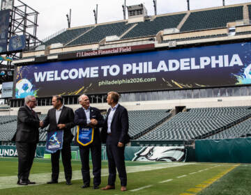 Philadelphia Mayor Jim Kenney posed with delegates from FIFA and United States Soccer at Lincoln Financial Field on September 22, 2021. Philadelphia is a candidate city to host the 2026 World Cup. (Kimberly Paynter/WHYY)