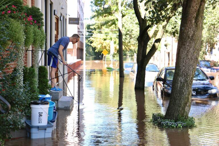 Water rises on Race Street near the Schuylkill River. (Emma Lee/WHYY)