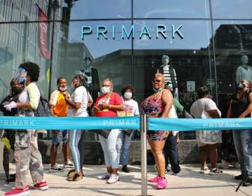 Customers line up outside the Primark store on Market Street. The line to get in to the grand opening of this latest addition to the Fashion District stretched around the block. (Emma Lee/WHYY)