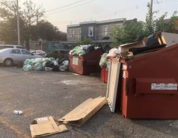 Lewis Elkin Elementary School with piles of garbage in its parking lot on Monday morning. (Emily Rizzo / WHYY)