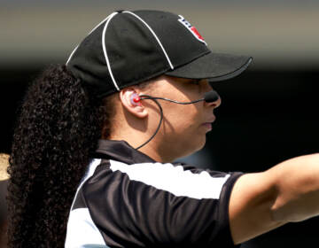 Line judge Maia Chaka #100 signals during the game between the Carolina Panthers and the New York Jets at Bank of America Stadium on September 12, 2021 in Charlotte, North Carolina. (Photo by Grant Halverson/Getty Images)