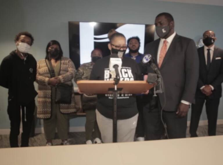 Kevin Mincey (right) comforts Rachel Briggs (left) as she speaks at a press conference