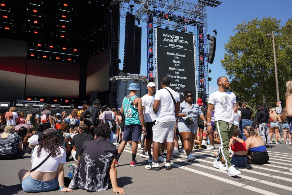 People wait in front of the Rocky Stage prior to the first set at the 2021 Made in America festival