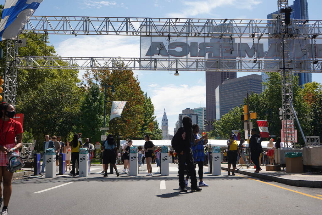 People walk through a second round of security as they enter the festival gates
