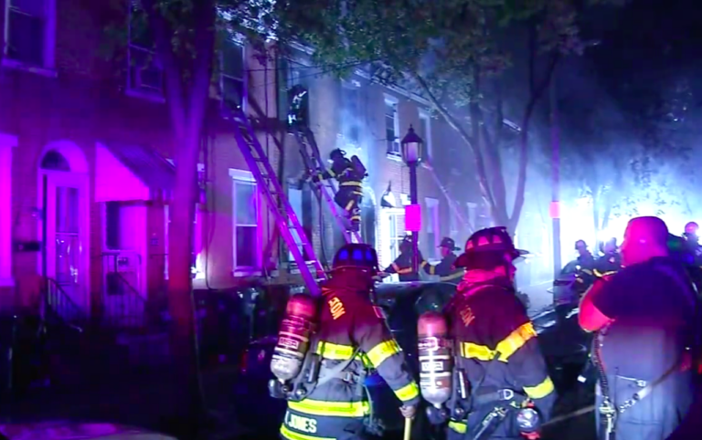 Fire crews at a rowhome fire that broke out in Wilmington, Del. (6abc)