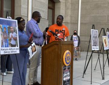 Kimberly Kamara and her husband Kesselle, pictured with Council member Kenyatta Johnson, lost their 23-year-old son Niam Johnson-Tate to gun violence in 2017. (Aaron Moselle, WHYY)