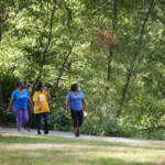 A group of people are pictured walking in a Philadelphia park