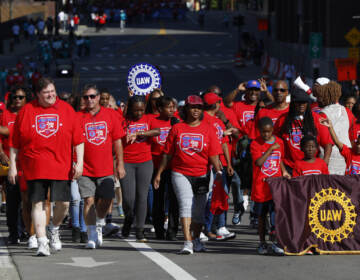 United Auto Workers members walk in the Labor Day parade