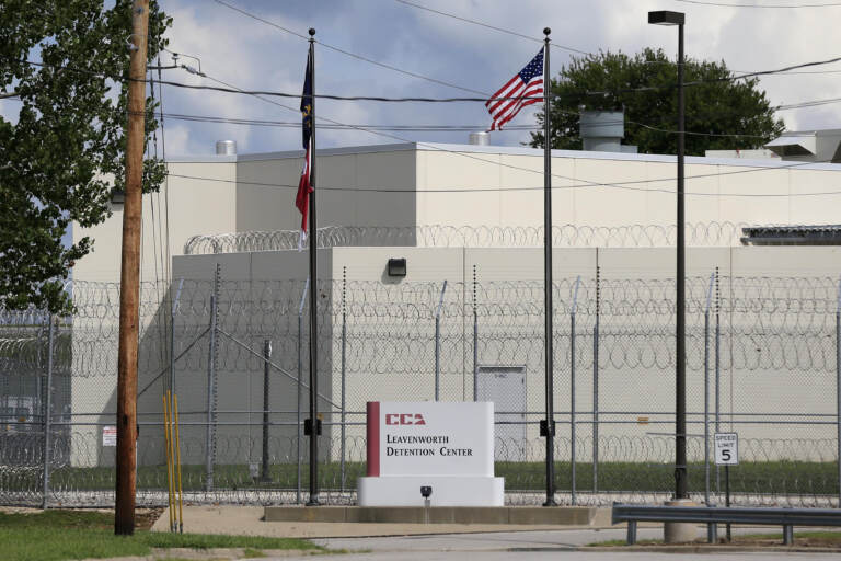 The main gate of the privately-run Leavenworth Detention Center in a 2016 file photo. At the time, the prison's operator was known as the Corrections Corporation of America but has since been renamed CoreCivic. Legal advocates are hoping the facility shuts down when its federal contract ends at the end of the 2021.