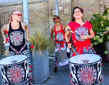 Members of Batalá Philly play the drums