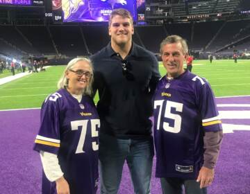 Minnesota Vikings star lineman Brian O'Neill (center) poses after a 2019 home game with his uncle and aunt, Delaware Gov. John Carney and First Lady Tracey Quillen
