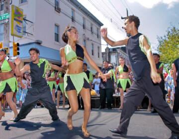 Dancers perform during Feria del Barrio