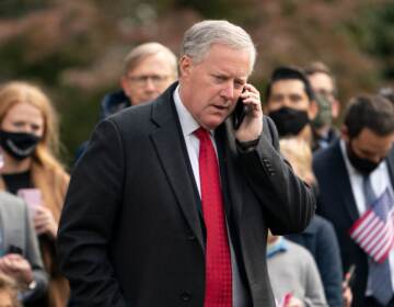 White House Chief of Staff Mark Meadows speaks on his phone as he waits for US President Donald Trump to depart the White House on October 30, 2020 in Washington, D.C.