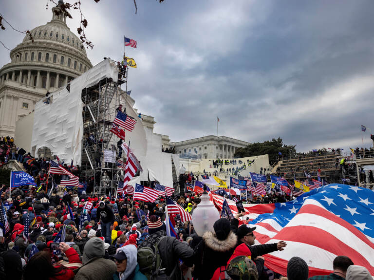 Trump supporters clash with police and security forces as people try to storm the US Capitol on January 6, 2021 in Washington, DC