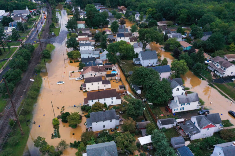 An aerial view of flooded streets are seen in Helmetta