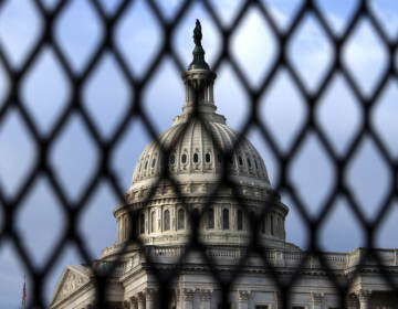 The U.S. Capitol Dome is seen through security fencing in May. Similar barriers will be in place on Saturday, when a demonstration is planned in support of people charged for the Jan. 6 pro-Trump attack on the Capitol. (Chip Somodevilla/Getty Images)