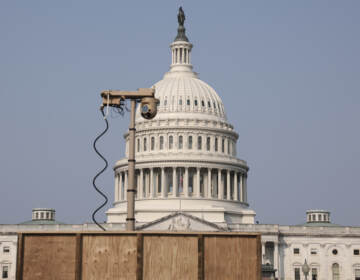 A recently installed surveillance camera is positioned near the U.S. Capitol on Monday. (Anna Moneymaker/Getty Images)