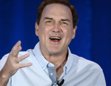 Norm Macdonald speaks during a panel discussion of reality television talent show