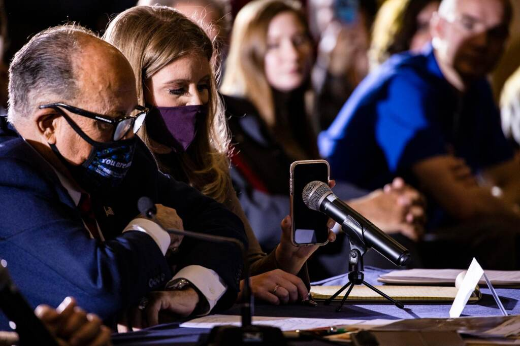 Jenna Ellis sits next to Rudy Giuliani at a meeting in Gettysburg