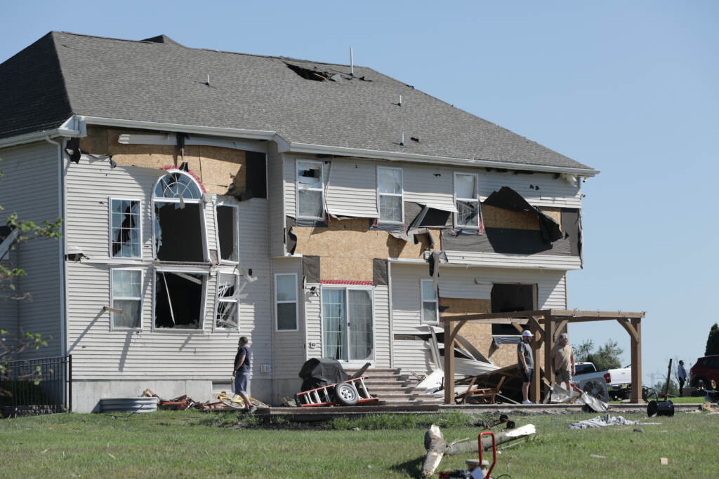 A home is seen with major damage in Mullica Hill