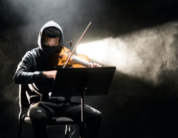 Violinist Randall Mitsuo Goosby is pictured playing