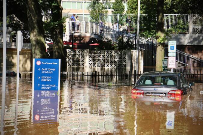 A car is swamped at Park Towne Place apartments off 22nd Street near the Vine Street Expressway. (Emma Lee/WHYY)