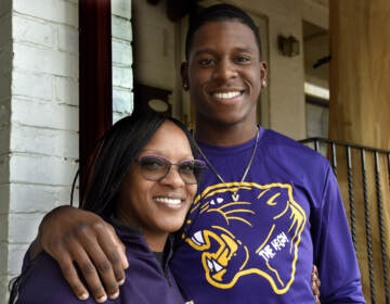 Danielle Carter and her son Vance Carter outside their Camden home