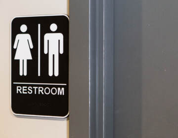 A sign is pictured outside a bathroom.