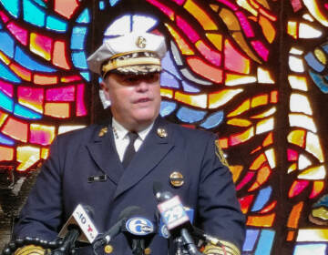 Fire Commissioner Adam Thiel speaks at a press conference