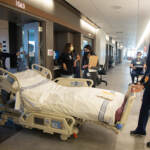 A team of medical professionals rehearsehow to bring a patient in a care bed to another floor during a dressrehearsal of different patient scenariosin the new Pavilion building at the Hospital of the University of Pennsylvania
