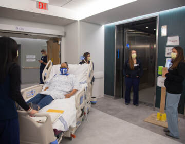 A team of medical professionals rehearsehow to bring a mock patient in a care bed to another floor during a dressrehearsal of different patient scenariosin the new Pavilion building at the Hospital of the University of Pennsylvania