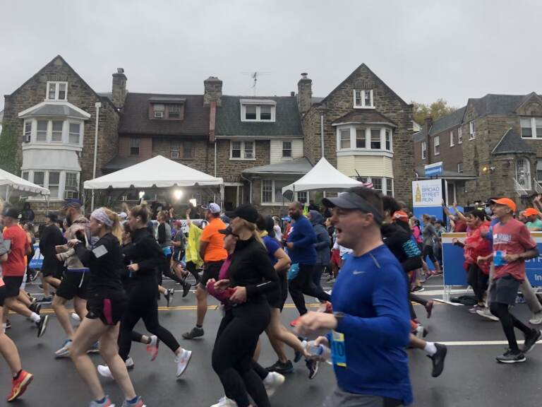 Runners take off at the start of at the start of the Broad Street Run. Participants had to provide proof of vaccination. (Mallory Falk, WHYY)
