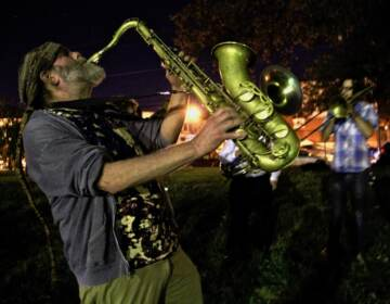 Saxophonist Elliot Levin and other members of the West Philadelphia Orchestra play outside a polling place at the Salvation army building at 55th and Market streets. The orchestra  (Emma Lee/WHYY)