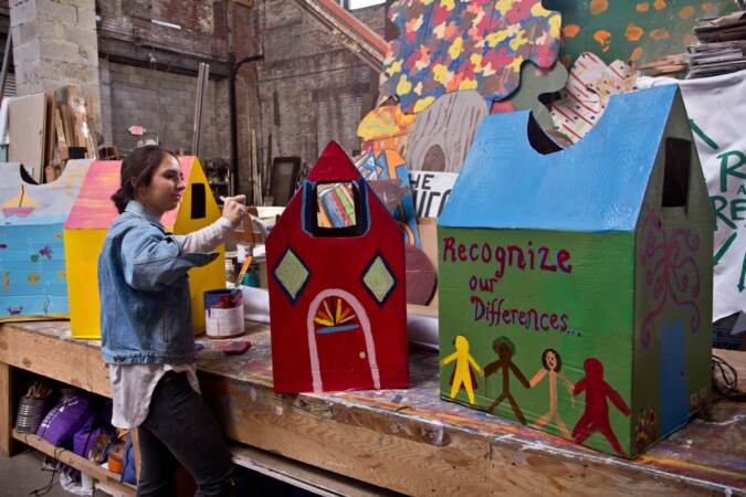 Spiral Q apprentice Laura Beery paints houses for the Peoplehood parade on Oct. 17, 2017. The houses, along with 80 percent of Spiral Q's puppet colection, were destroyed by flooding