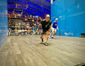 Diego Elías of Peru (in black) plays against Mohamed el Shorbagy of Egypt (in blue), in the US Open for squash at the new Arlen Spector Squash Center on the campus of Drexel University
