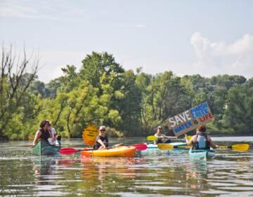 Protesters of Sunoco's Mariner East Pipline kayaked to a clean-up site on Marsh Creek Lake in Chester County, Pa., where the DEP says 8,000 gallons of drilling mud migrated into the stream. (Kimberly Paynter / WHYY)
