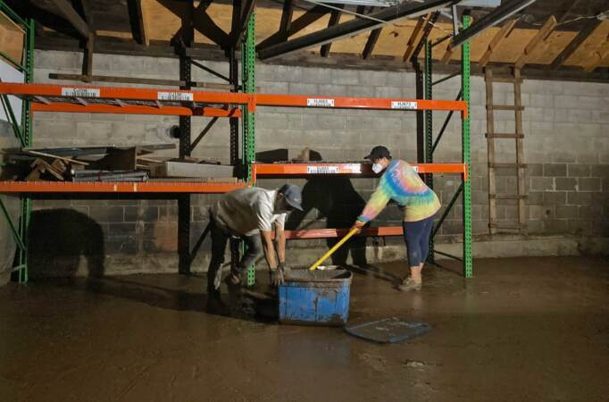 Volunteers with Spiral Q spent an evening digging mud out of the storage garage near Phoenixville, Pa., flooded by the Schuylkill River during Hurricane Ida on September 1