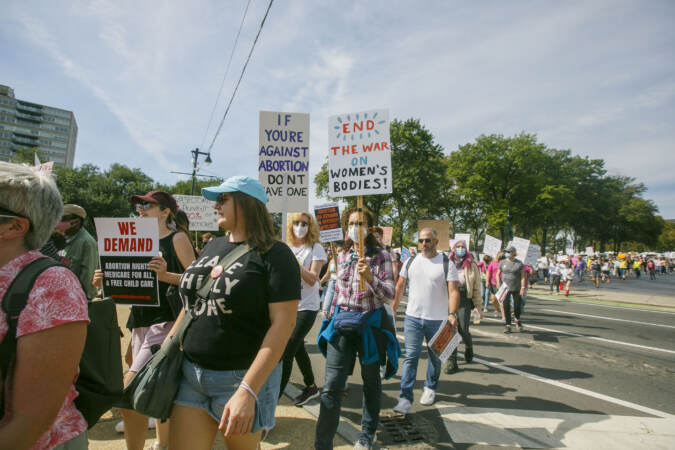 Marchers walk from the art museum to Philadelphia City Hall as part of an abortion rights rally held in Philadelphia, PA on Saturday, Oct. 2, 2021. Hundreds gather in Philadelphia as part of