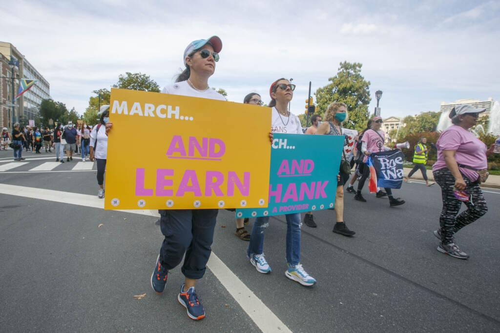 """Marchers walk from the art museum to Philadelphia City Hall as part of an abortion rights rally held in Philadelphia, PA on Saturday, Oct. 2, 2021. Hundreds gather in Philadelphia as part of """"Bans Off Our Bodies"""" marches that were held across the country today."""