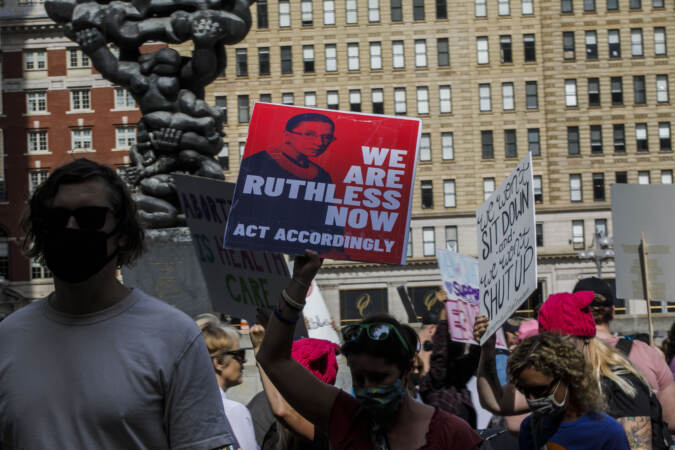 Marchers hold up signs outside Philadelphia City Hall as part of an abortion rights rally held in Philadelphia, PA on Saturday, Oct. 2, 2021. Hundreds gather in Philadelphia as part of