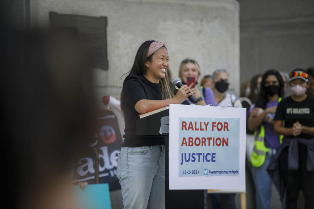 """Jessica Chen, a resident physician in obstetrics-gynecology, University of Pennsylvania, speaks in front of Philadelphia City Hall as part of an abortion rights rally held in Philadelphia, PA on Saturday, Oct. 2, 2021. Hundreds gather in Philadelphia as part of """"Bans Off Our Bodies"""" marches that were held across the country today"""